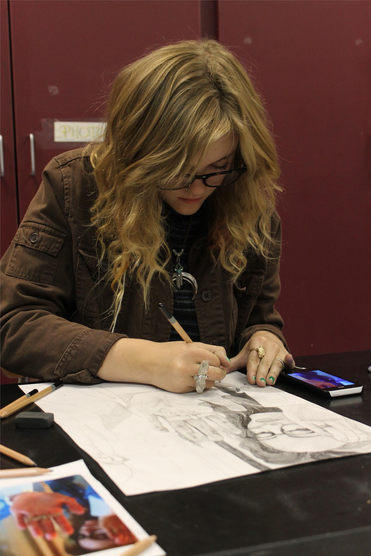 Nikola working on her self portrait